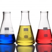 38391034 - laboratory glassware with blue,yellow and red liquid